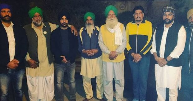 inside pic of gurwinder with farmer