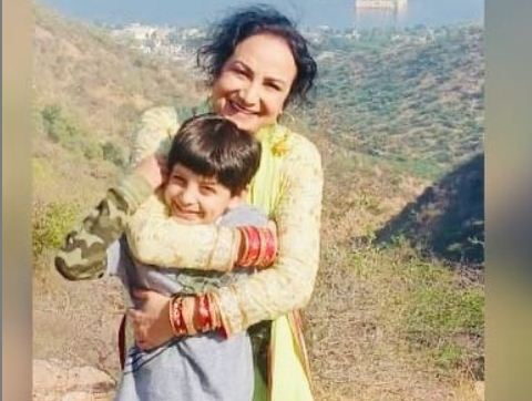 inside image of satwinder bitti with son