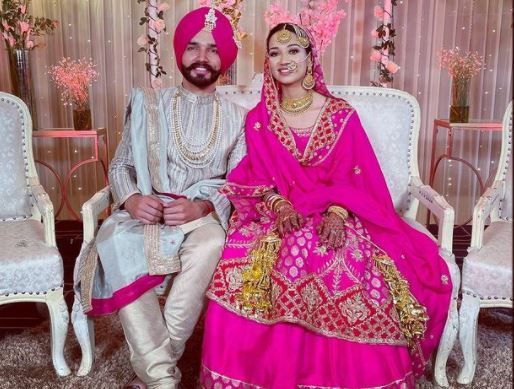 inside image of sukh kharoud with his wife