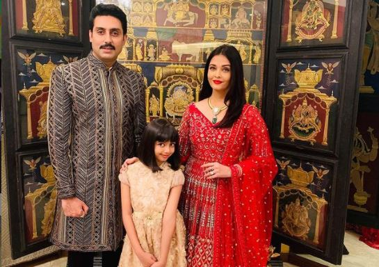 inside image of abishek bachachan with wife and daughter