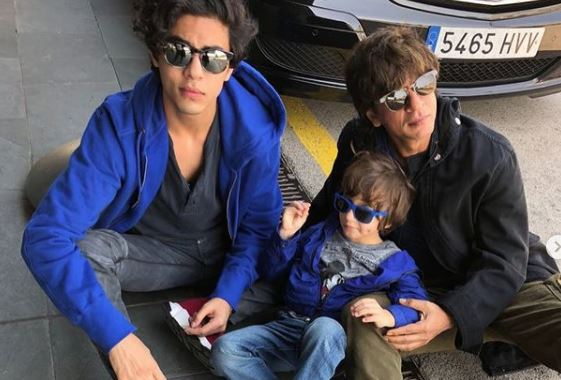 inside image of shah ruk khan with son